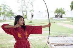 Girl practicing archery Stock Images