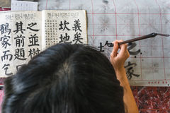 Girl practicing chinese callingraphy Stock Images