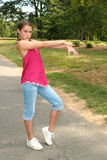 Girl Practicing Dance Moves in a Park Stock Image
