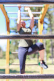 Girl practicing fitness. Close up of a wooden beam.Behind it, there is a girl who is doing exercises royalty free stock photo