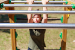 Girl practicing fitness. During the midday, girl doing gymnastic exercises on a wooden structure made for practicing different type of exercise. She is inside an stock photos