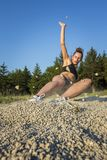 Girl practicing long jump Stock Photos