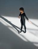 Girl practicing rhythmic gymnastics in  gym Royalty Free Stock Photography