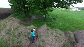 Girl practicing shooting at targets. In countryside, aerial video stock video footage