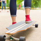 Girl practicing urban long board riding. Stock Photography
