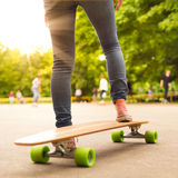 Girl practicing urban long board riding. Royalty Free Stock Photo