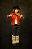 Girl practicing the violin Stock Photography