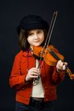 Girl practicing the violin Royalty Free Stock Photos