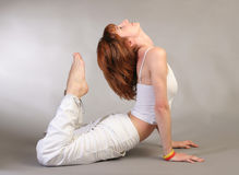Girl practicing yoga Royalty Free Stock Photo