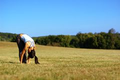 Girl Practicing Yoga In Field Royalty Free Stock Photo