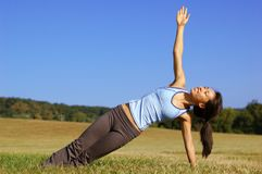 Girl Practicing Yoga In Field stock photography
