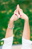 Girl practicing yoga hands Royalty Free Stock Photo