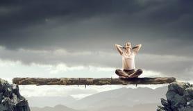 Girl practicing yoga . Mixed media Royalty Free Stock Photos