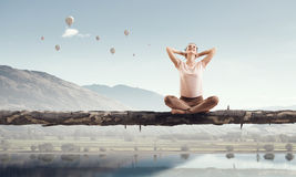 Girl practicing yoga . Mixed media Royalty Free Stock Images
