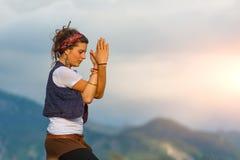 Girl practicing yoga Stock Photos