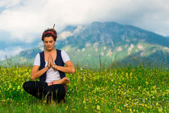 Girl practicing yoga in nature Stock Images
