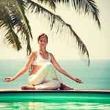 Girl practicing yoga. Royalty Free Stock Photography