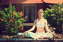 Girl practicing yoga. Stock Photos