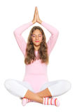 Girl practicing yoga Stock Images