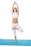 Girl practicing yogatic asana Royalty Free Stock Photos