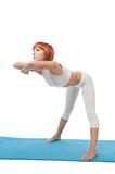 Girl practicing yogatic asana Royalty Free Stock Photos