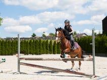Girl practising horse riding Royalty Free Stock Image