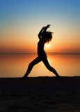 The girl is practising yoga. Royalty Free Stock Photos