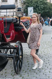 Girl in Prague and Chariot. Girl in the streets of Prague posing in front of a tourist chariot, Czech Republic, Europe Royalty Free Stock Photos