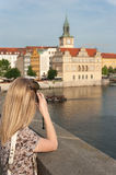 Girl in Prague Taking Photos Royalty Free Stock Photography
