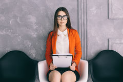 Girl prapering for job interview  in waiting room Stock Photography