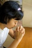 Girl pray in church Stock Images