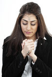 Girl in prayer Stock Photos