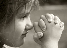 Girl in Prayer Stock Photo