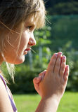 Girl in Prayer. Closeup of a girl in prayer in black and white Royalty Free Stock Images