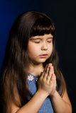 Girl praying. A photo of a girl, praying, isolated Royalty Free Stock Photography