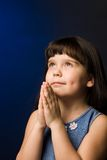 Girl praying. A photo of a girl, praying, isolated Stock Photo