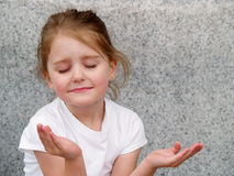 Girl praying Stock Photos