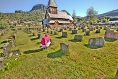 Woman praying at graveside Stock Photo