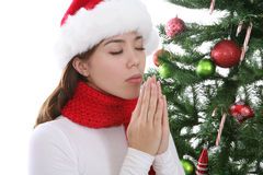 Girl Praying at Christmas Stock Photos
