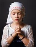 Girl Praying. A closeup of a 8 year old girl praying stock photography