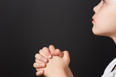 Girl Praying. A closeup of a 8 year old girl with head cover praying royalty free stock photos