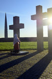 Girl praying at the Crosses Stock Image