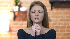 Girl praying for Forgiveness, Portrait. High quality stock images