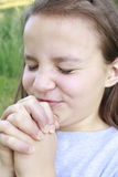 Girl Praying Hard Royalty Free Stock Photos