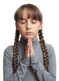 Girl praying, isolated. Beautiful little girl praying - closeup, isolated Royalty Free Stock Image