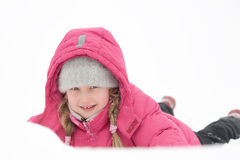 Girl praying with snow. Girl playing with snow and having fun outdoor Royalty Free Stock Photography