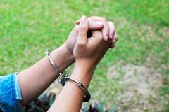 Girl Praying to God with Handcuffed on Her Hands royalty free stock photography