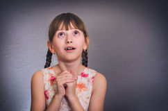The girl prays. Stock Images