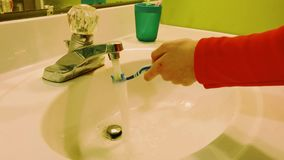 A kid brushing a flossing stock footage