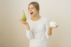 Girl prefers pear instead of cae Stock Images